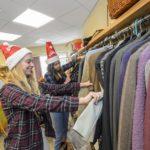 Students sort clothes at Katrina's Closet